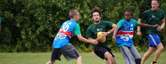 Campers Playing Aussie Rules Football